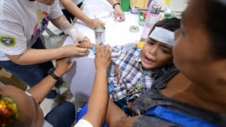 A health  treats a boy Suffered  Dengay Hyperpyrexia in Cabatuan, Philiphines Last Month